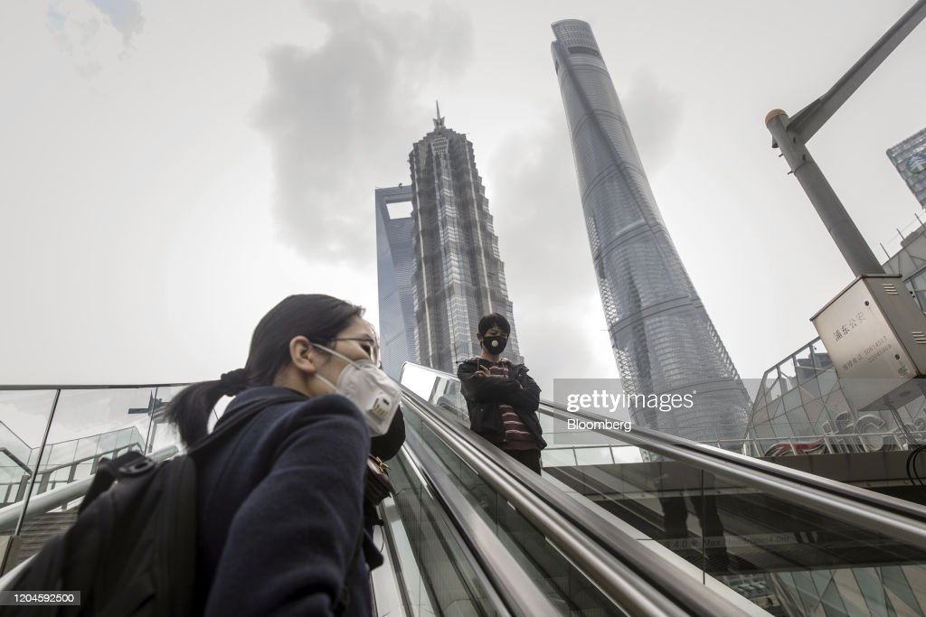 Pedestrians Wearing Protective Masks Ride An Escalator In The News Photo Getty Images