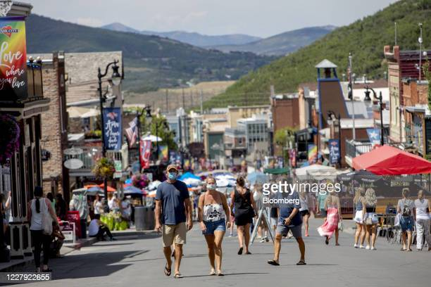 Pedestrians wearing protective masks walk on Main Street in Park City Utah US on Saturday Aug 1 2020 From California's wine country to Colorado's ski...