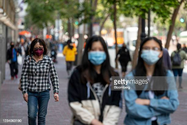 Pedestrians wearing protective masks walk on Market Street in San Francisco, California, U.S., on Monday, July 19, 2021. Officials in the San...
