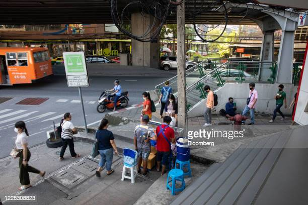 Pedestrians wearing protective masks walk outside a Bangkok Mass Transit System subway station in Bangkok Thailand on Wednesday Sept 2 2020...