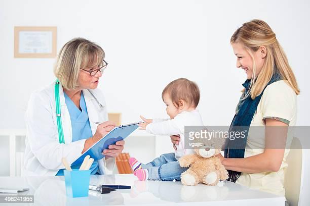 Pediatrician doing an infant medical exam.