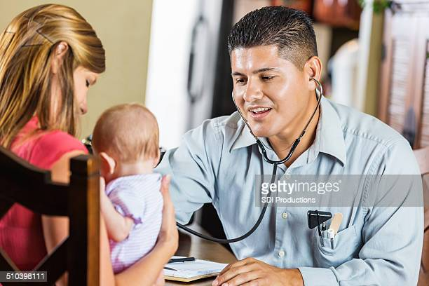 Pediatrician listening to lungs and heartbeat of infant patient
