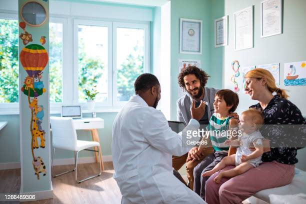 pediatrician's office - doctor stock pictures, royalty-free photos & images