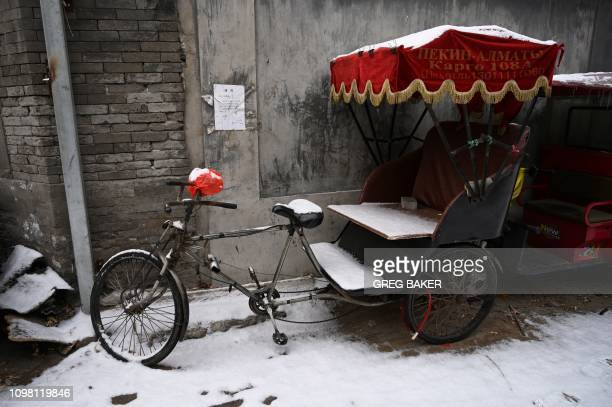A pedicab is seen in an alley after a snowfall in Beijing on February 12 2019
