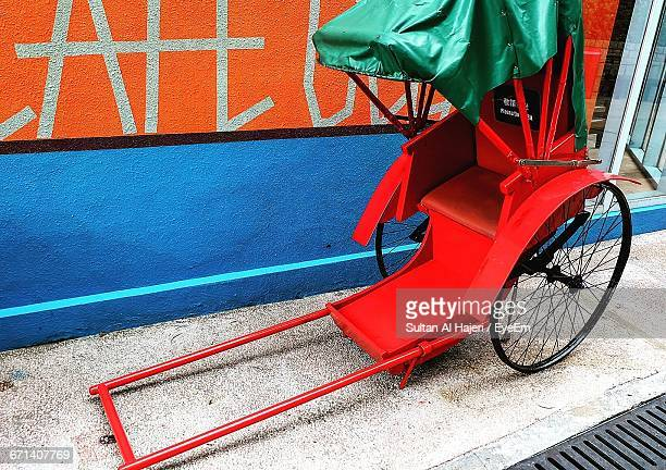 Pedicab Parked Against Wall