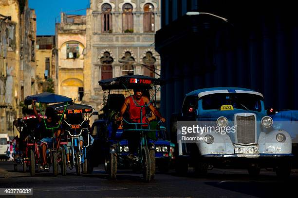 Pedicabs and taxis travel on a street in downtown Havana Cuba on Sunday Feb 1 2015 Declaring that decades of US policy had failed to promote...