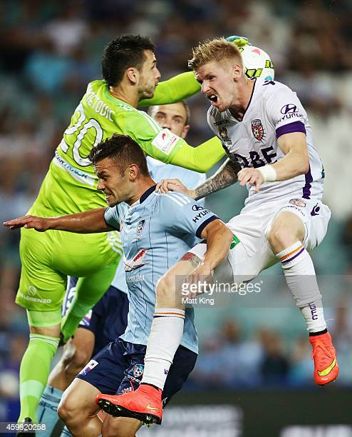 Pedj Bojic of Sydney FC competes for the ball against Andy Keogh of Perth Glory as Sydney FC goalkeeper Vedran Janjetovic grabs the ball during the...