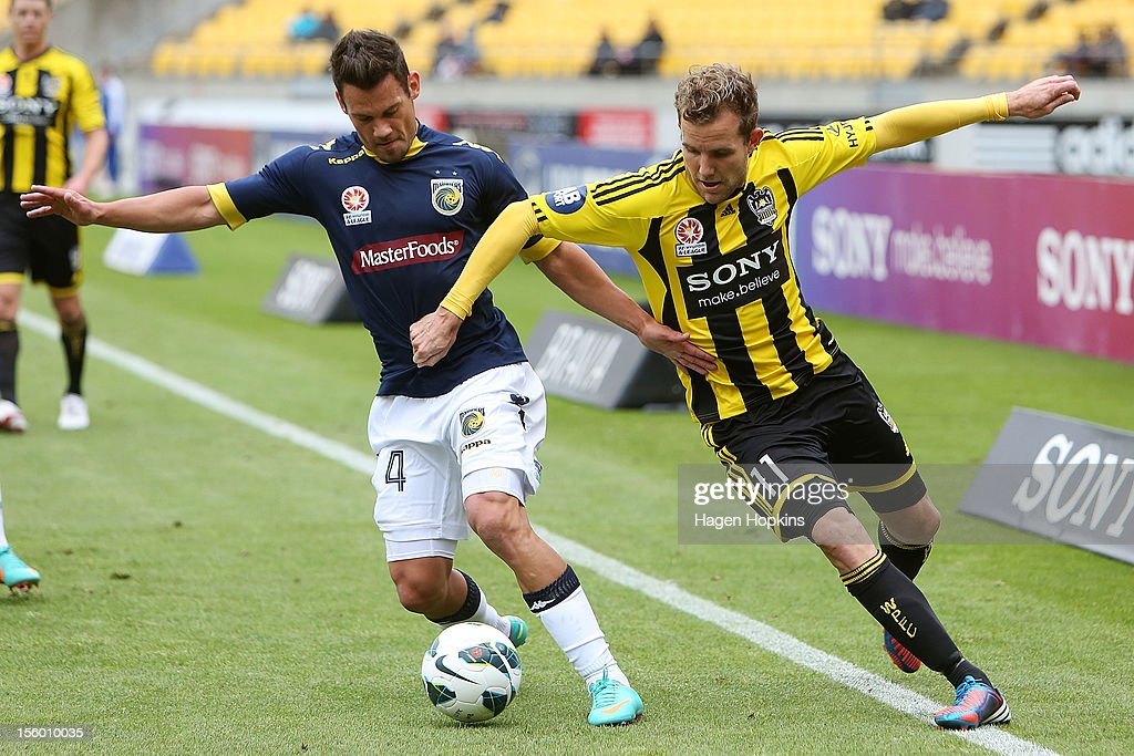 Pedj Bojic of the Mariners and Jeremy Brockie of the Phoenix compete for the ball during the round six A-League match between the Wellington Phoenix and the Central Coast Mariners at Westpac Stadium on November 11, 2012 in Wellington, New Zealand.