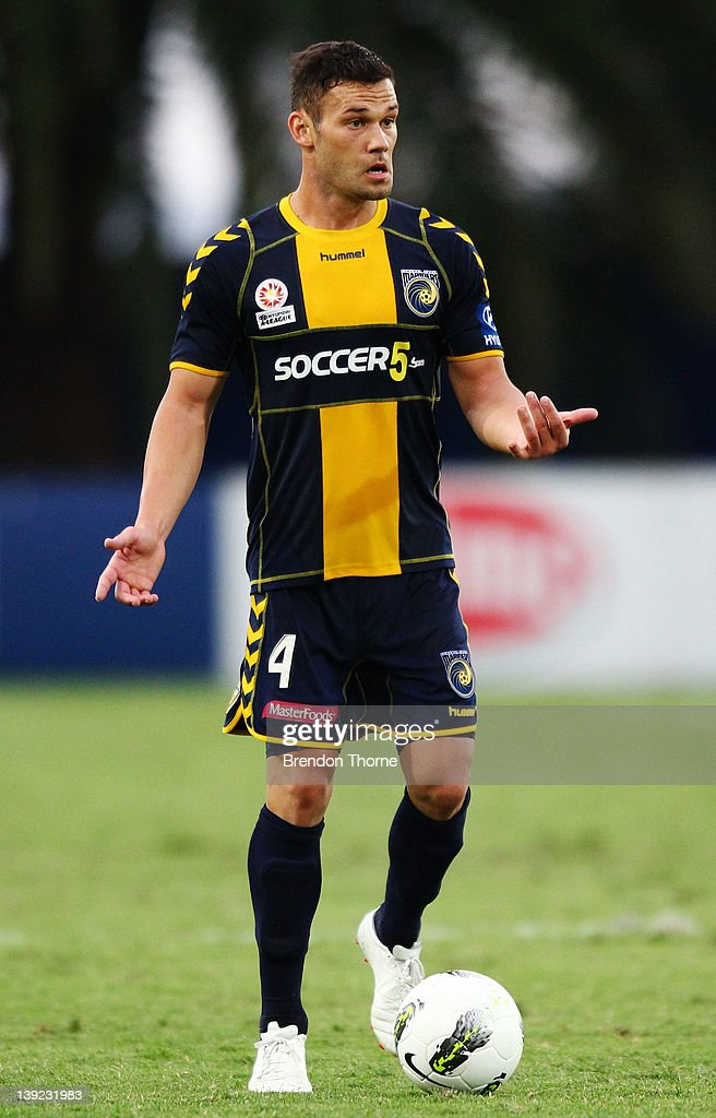 Pedj Bojic of the Mariners gestures on the ball during the round 20 A-League match between the Central Coast Mariners and the Wellington Phoenix at Bluetongue Stadium on February 18, 2012 in Gosford, Australia.