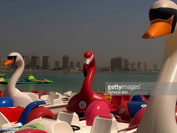 Pedlow boats are moored off the Qatari capital Doha with Pearl Island seen in the background on October 4 2012 Formerly a British protectorate Qatar...