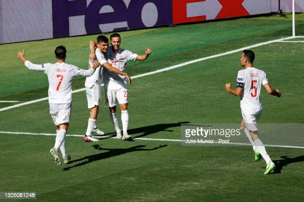 Pedri and Pablo Sarabia of Spain celebrate their side's first goal, an own goal by Martin Dubravka of Slovakia during the UEFA Euro 2020 Championship...