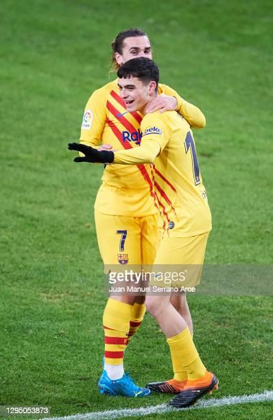 Pedri Gonzalez of Barcelona celebrates with Antoine Griezmann of Barcelona after scoring his sides first goal during the La Liga Santander match...