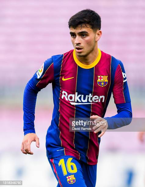 Pedri of FC Barcelona looks on during the La Liga Santander match between FC Barcelona and RC Celta at Camp Nou on May 16, 2021 in Barcelona, Spain....