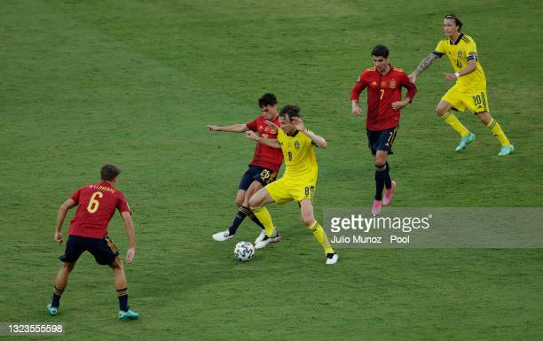 Pedri of Spain battles for possession with Albin Ekdal of Sweden during the UEFA Euro 2020 Championship Group E match between Spain and Sweden at the...