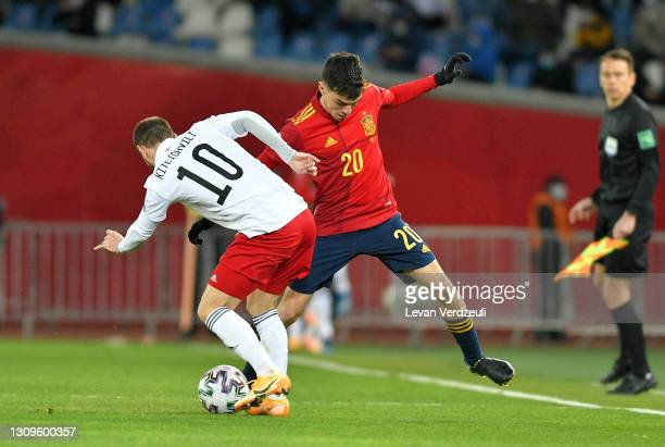 Pedri of Spain battles for possession with Otar Kiteishvili of Georgia during the FIFA World Cup 2022 Qatar qualifying match between Georgia and...