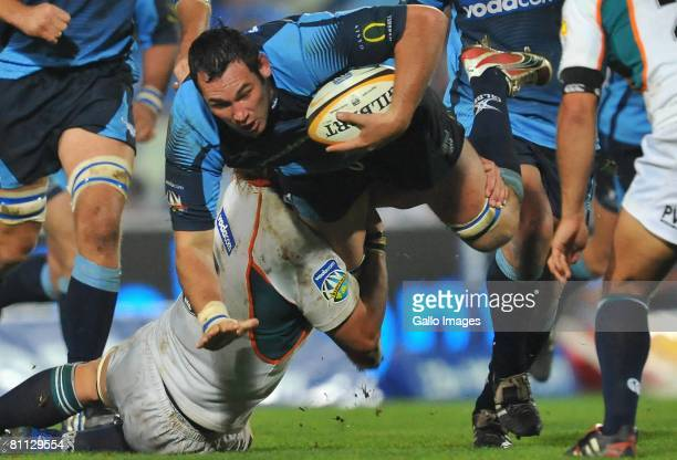 Pedrie Wannenburg of the Blues is tackled during the Super 14 match between the Cheetahs and Blue Bulls held at Vodacom Park on May 17, 2008 in...