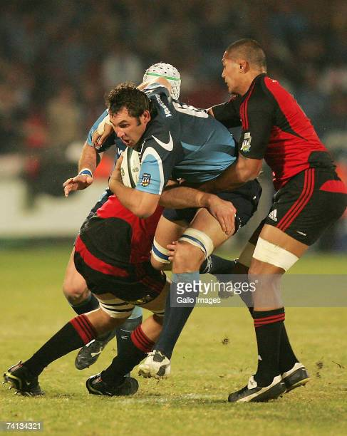 Pedrie Wannenburg tackled during the Super 14 semifinal match between the Vodacom Bulls and the Crusaders held at the Loftus Versfeld Stadium on May...