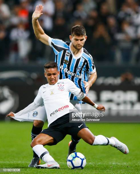 Pedrinho of Corinthians and Walter Kannemann of Gremio in action during the match for the Brasileirao Series A 2018 at Arena Corinthians Stadium on...