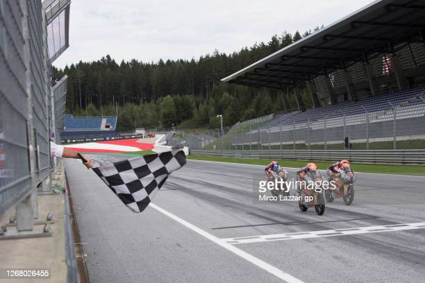 Pedro Acosta of Spain crosses the finish lane and wins at the end of the Red Bull Rookies Cup race 2 during the MotoGP Of Styria - Race at Red Bull...
