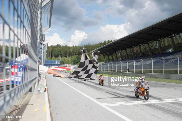 Pedro Acosta of Spain cuts the finish lane and celebrates the victory during the Red Bull Rookies Cup race 2 during the MotoGP Of Austria - Race at...