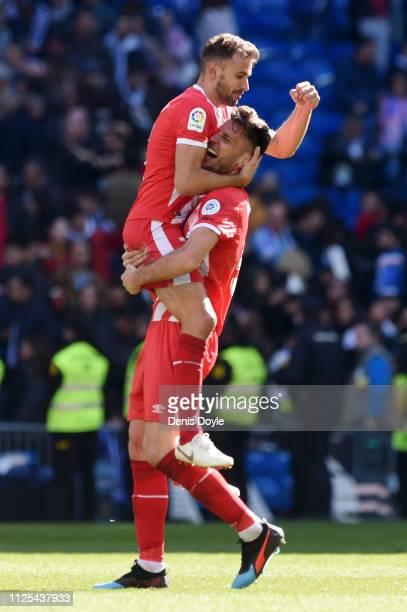 Pedro Alcala celebrates victory with Cristhian Stuani of Girona following the La Liga match between Real Madrid CF and Girona FC at Estadio Santiago...