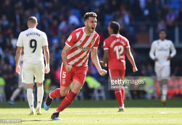 Pedro Alcala of Girona celebrates victory following the La Liga match between Real Madrid CF and Girona FC at Estadio Santiago Bernabeu on February...