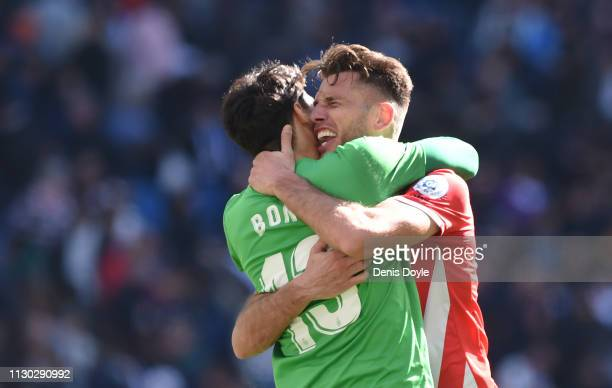 Pedro Alcala of Girona celebrates victory with Yassine 'Bono' Bounou following the La Liga match between Real Madrid CF and Girona FC at Estadio...