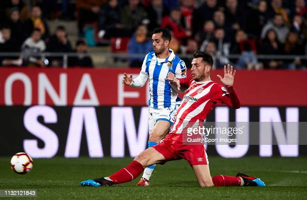 Pedro Alcala of Girona FC fights for the ball with Juanmi Jimenez of Real Sociedad during the La Liga match between Girona FC and Real Sociedad at...