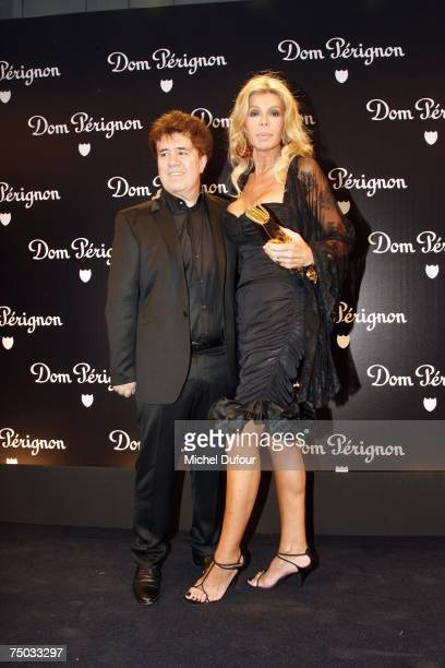 Pedro Almodovar and Bibi Anderson attends the Karl Lagerfeld party hosted by Dom Perignon at Lagerfeld's home on July 4 2007 in Paris France