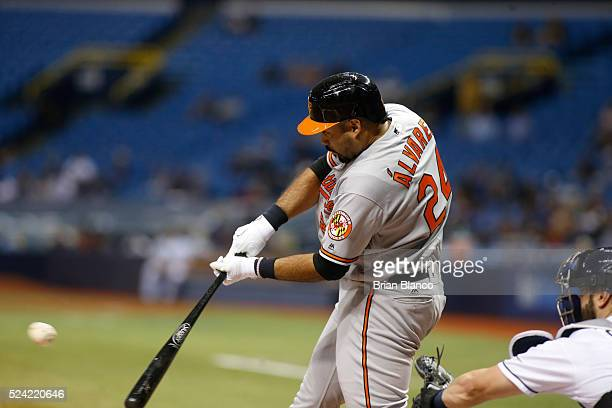 Pedro Alvarez of the Baltimore Orioles hits a double in front of catcher Curt Casali of the Tampa Bay Rays during the third inning of a game on April...