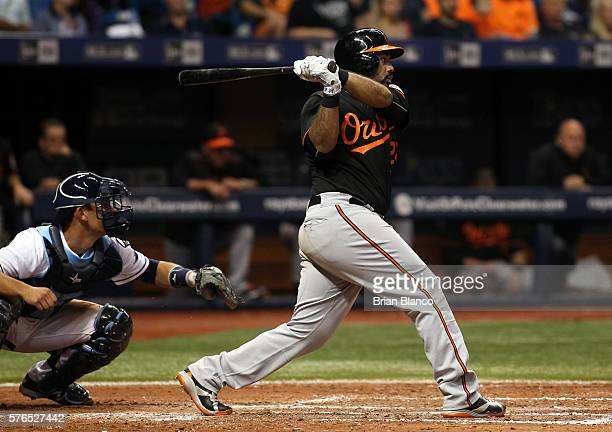 Pedro Alvarez of the Baltimore Orioles hits an RBI double in front of catcher Luke Maile of the Tampa Bay Rays to score JJ Hardy during the fifth...