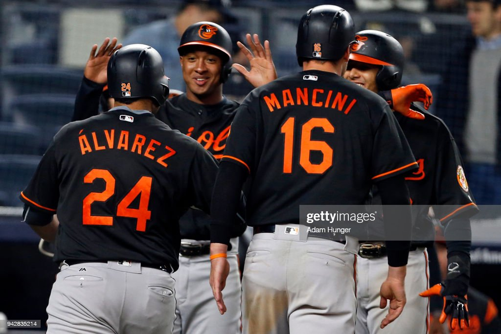 Pedro Alvarez #24 of the Baltimore Orioles is congratulated by teammates after hitting a grand slam home run against the New York Yankees during the fourteenth inning at Yankee Stadium on April 6, 2018 in the Bronx borough of New York City. The Orioles won 7-3.