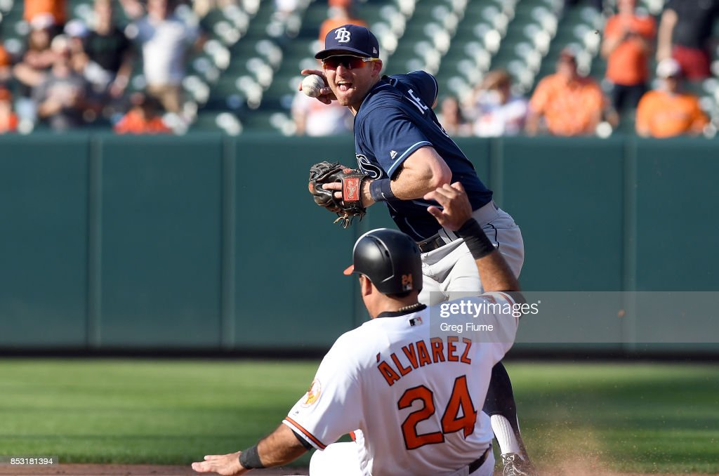 Pedro Alvarez #24 of the Baltimore Orioles is forced out at second base by Brad Miller #13 of the Tampa Bay Rays at Oriole Park at Camden Yards on September 24, 2017 in Baltimore, Maryland.