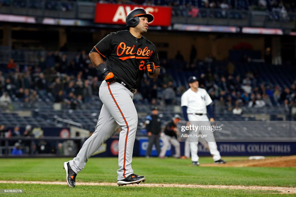 Pedro Alvarez #24 of the Baltimore Orioles rounds the bases after hitting a grand slam home run off of Jonathan Holder #56 of the New York Yankees during the fourteenth inning at Yankee Stadium on April 6, 2018 in the Bronx borough of New York City. The Orioles won 7-3.