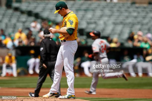 Pedro Alvarez of the Baltimore Orioles rounds the bases after hitting a home run off of Andrew Triggs of the Oakland Athletics during the second...