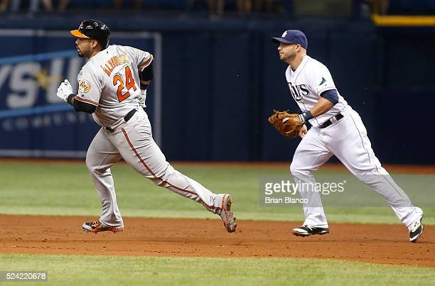 Pedro Alvarez of the Baltimore Orioles runs by first baseman Steve Pearce of the Tampa Bay Rays after hitting a double off of pitcher Chris Archer...
