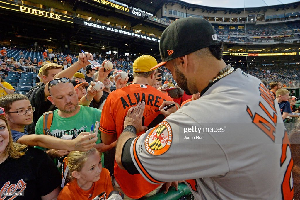 Pedro Alvarez #24 of the Baltimore Orioles signs autographs for fans before the start of the game against the Pittsburgh Pirates at PNC Park on September 27, 2017 in Pittsburgh, Pennsylvania.