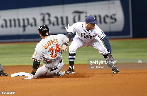 Pedro Alvarez of the Baltimore Orioles slides safely into second base ahead of shortstop Brad Miller of the Tampa Bay Rays after hitting a double...