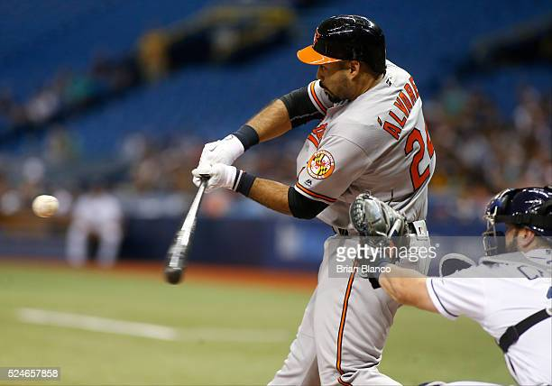 Pedro Alvarez of the Baltimore Orioles strikes out swinging in front of catcher Curt Casali of the Tampa Bay Rays during the second inning of a game...