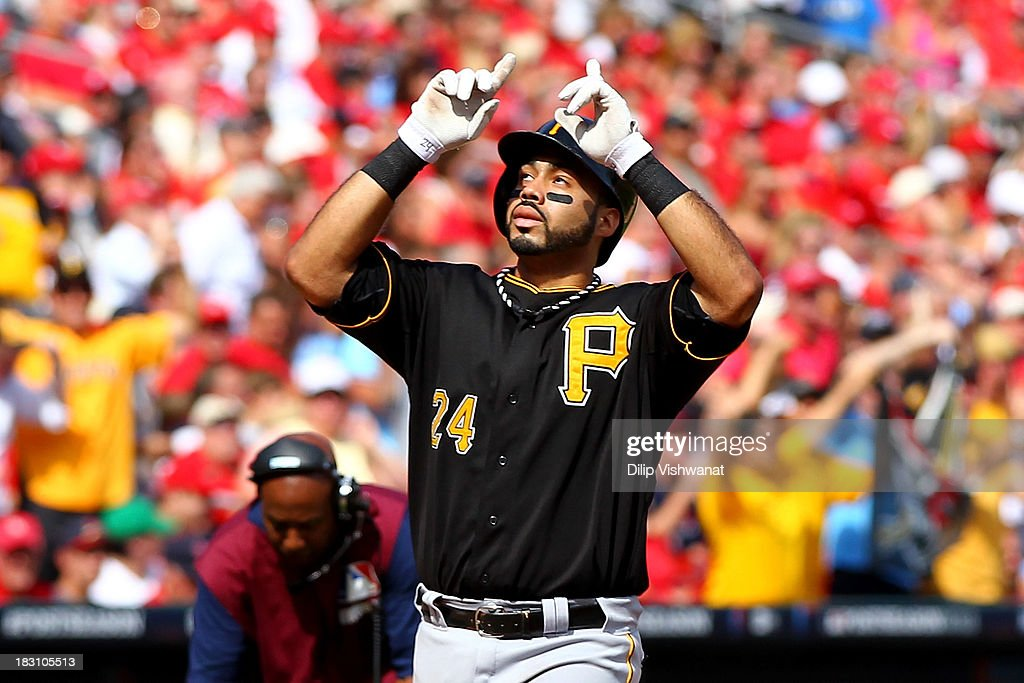 Pedro Alvarez #24 of the Pittsburgh Pirates celebrates after hitting a two-run home run in the third inning against the St. Louis Cardinals during Game Two of the National League Division Series at Busch Stadium on October 4, 2013 in St Louis, Missouri.