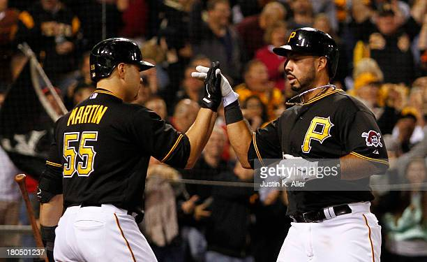Pedro Alvarez of the Pittsburgh Pirates celebrates after scoring on an insidethepark home run in the fourth inning against the Chicago Cubs during...