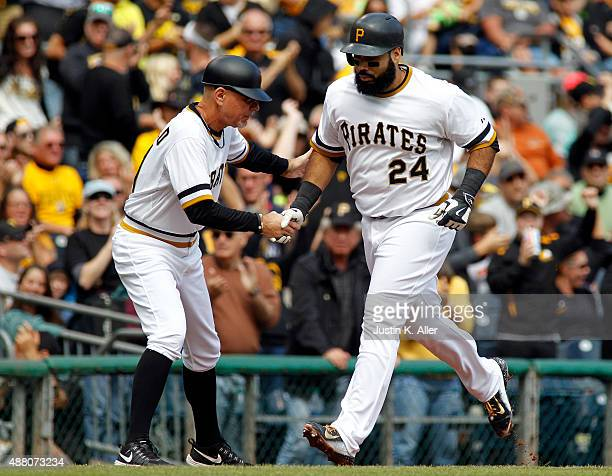 Pedro Alvarez of the Pittsburgh Pirates celebrates with Rick Sofield after hitting a home run in the second inning during the game against the...