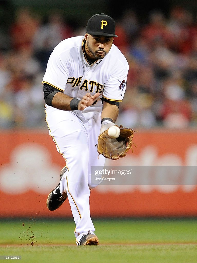 Pedro Alvarez #24 of the Pittsburgh Pirates fields a ground ball during the game against the Cincinnati Reds on September 29, 2012 at PNC Park in Pittsburgh, Pennsylvania. Pittsburgh won the game 2-1.