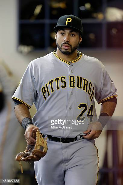 Pedro Alvarez of the Pittsburgh Pirates gets ready in the dugout before the game against the Milwaukee Brewers at Miller Park on April 12 2014 in...