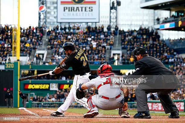Pedro Alvarez of the Pittsburgh Pirates hits a solo home run in the eighth inning against Michael Wacha of the St Louis Cardinals during Game Four of...