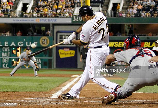 Pedro Alvarez of the Pittsburgh Pirates hits a three run home run in the third inning against the St Louis Cardinals during the game on August 29...