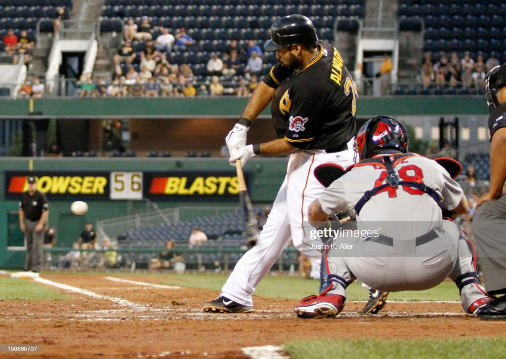 Pedro Alvarez #24 of the Pittsburgh Pirates hits a two-run home run in the third inning against the St. Louis Cardinals during the game on August 28, 2012 at PNC Park in Pittsburgh, Pennsylvania.