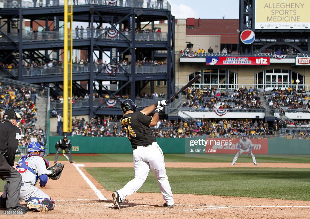 Pedro Alvarez #24 of the Pittsburgh Pirates hits an RBI single in the ninth inning against the Chicago Cubs during the opening day game on April 1, 2013 at PNC Park in Pittsburgh, Pennsylvania. The Cubs defeated the Pirates 3-1.