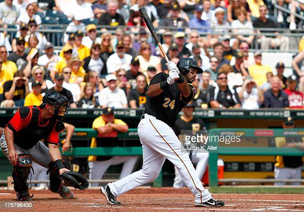 Pedro Alvarez of the Pittsburgh Pirates hits an RBI single in the fifth inning against the Miami Marlins during the game on August 8 2013 at PNC Park...