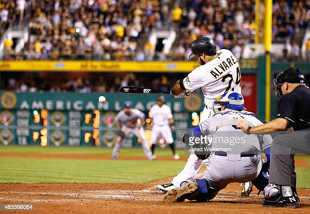 Pedro Alvarez of the Pittsburgh Pirates hits the gamewinning RBI single in the 10th inning against the Los Angeles Dodgers during the game at PNC...